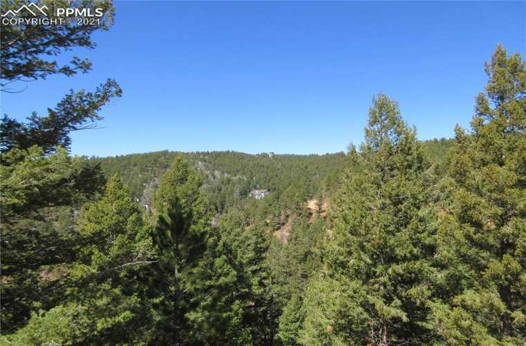 View is to the west from Rocky Point Lane just above the driveway access point to your new beautiful 2.55 acres of land with a wonderful view ready to build your dream home in the mountains in the highly sought-after gated community of Woodmoor Mountain.