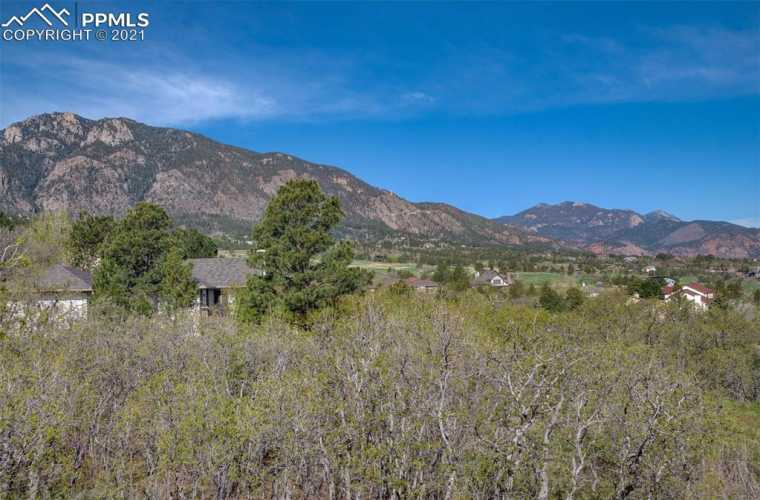 Panoramic views from top of lot of mountains, city, golf course and lake